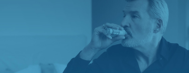 Man using respimat inhaler